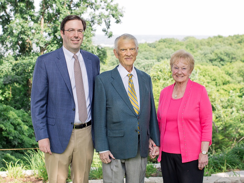 From left, Brian Matlaga, Jerry, and Helen Stephens pose with green trees in the background.