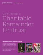 A small rectangular-shaped image of a cover of a brochure that has a purple background, small images of three people, and text about giving through a charitable remainder trust.