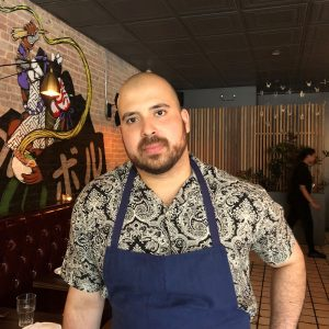 A portrait of Erick Vargas Bromberg in one of the restaurants he leads.