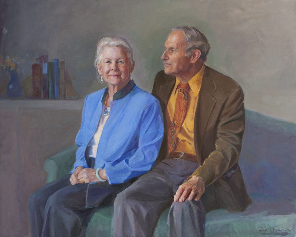 Sitting on a sofa, Sue and Tim Baker appear in a painted portrait.