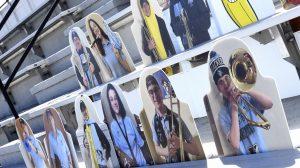 cardboard cutouts of fans in the bleachers at Homewood Field.