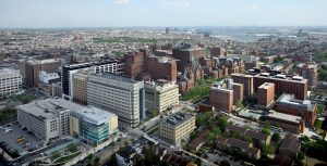 Aerial image of brick and stone city buildings that are part of the Johns Hopkins medical campus in Baltimore.